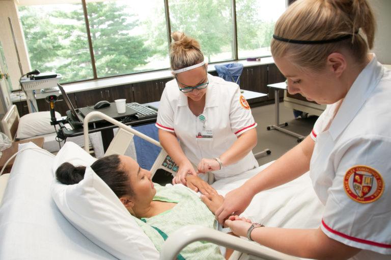 Nursing students treat a patient